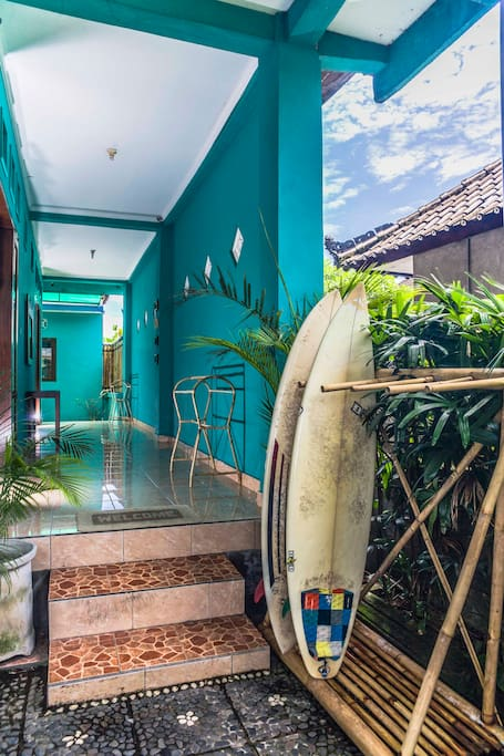 Entrance with surf board rack.