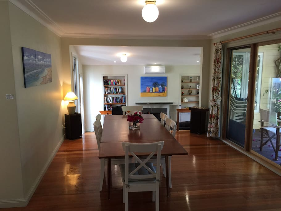 Teak table. Room for 8-10 for dinner. Steps down into living room 1 with open fire place