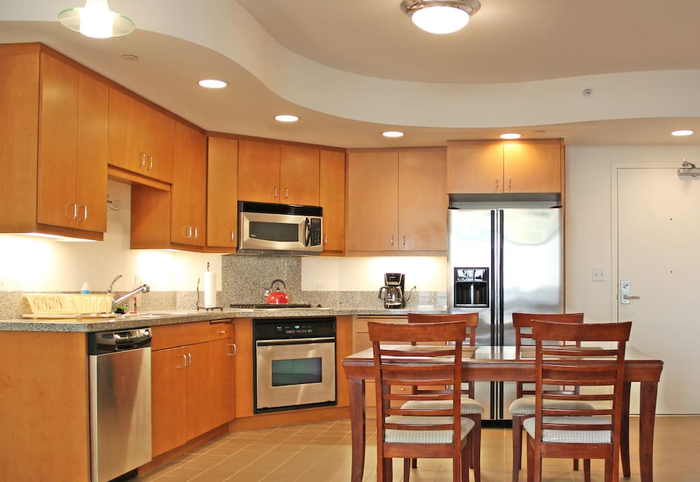 Kitchen Features: Stainless steel appliances and granite counter tops