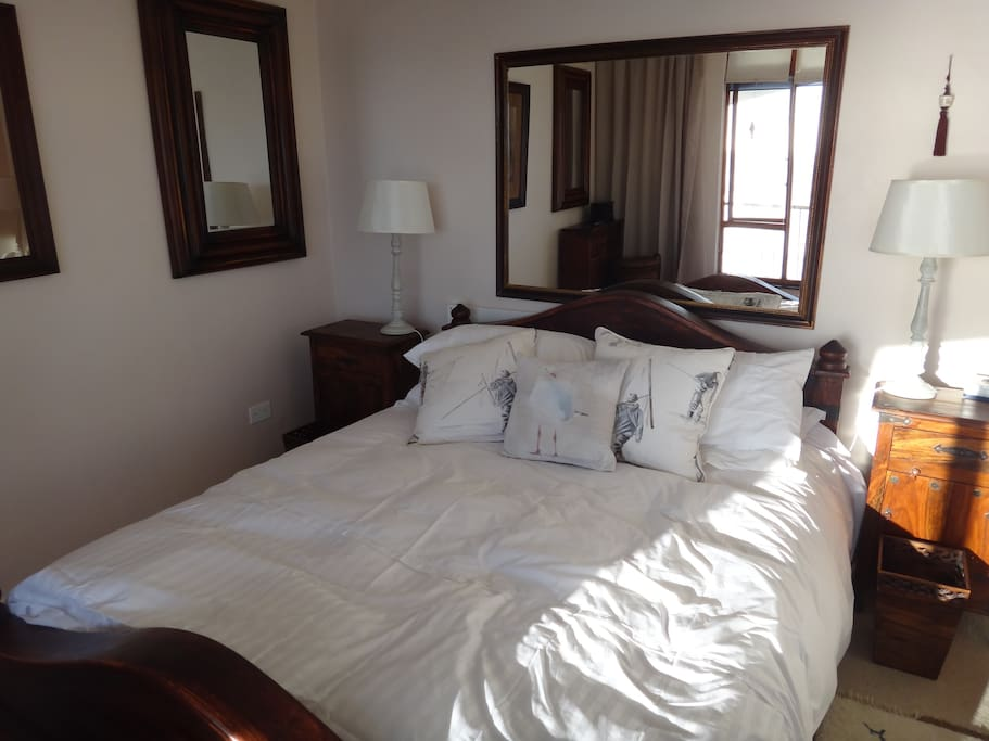 The main bedroom has a queen size bed overlooking the Atlantic ocean from the comfort of your bed
