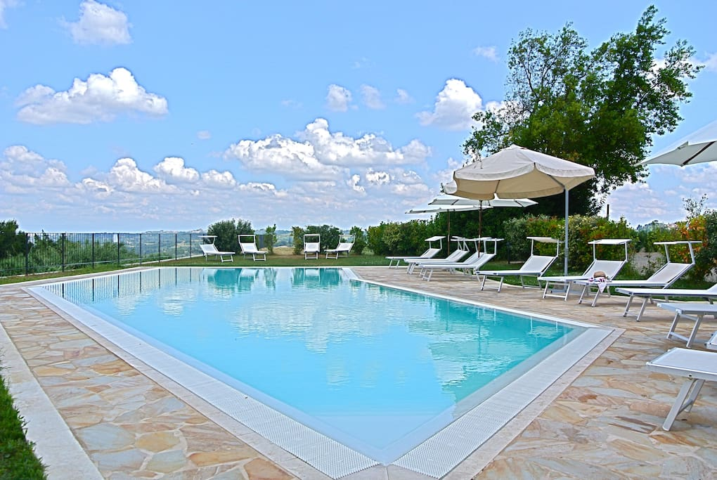 Relax by the pool and enjoy the breath taking tuscan view