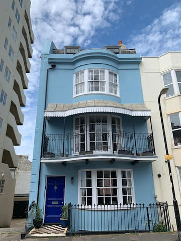Look for the blue house near the seafront! We are immediately opposite the Bedford Tavern