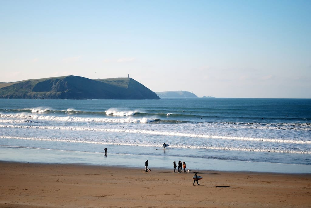 Polzeath beach is just around the headland from Port Quin. 5-10 mins in the car with the beach stuff. It's not far as the crow flies but if you are after a great hike along the coast path it will take a few hours, very well worth it for the spectacular vi