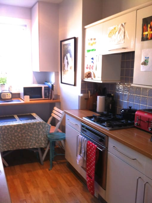 light galley kitchen with room to sit, microwave, oven, nespresso coffee, Pure radio, washing machine, dish washer