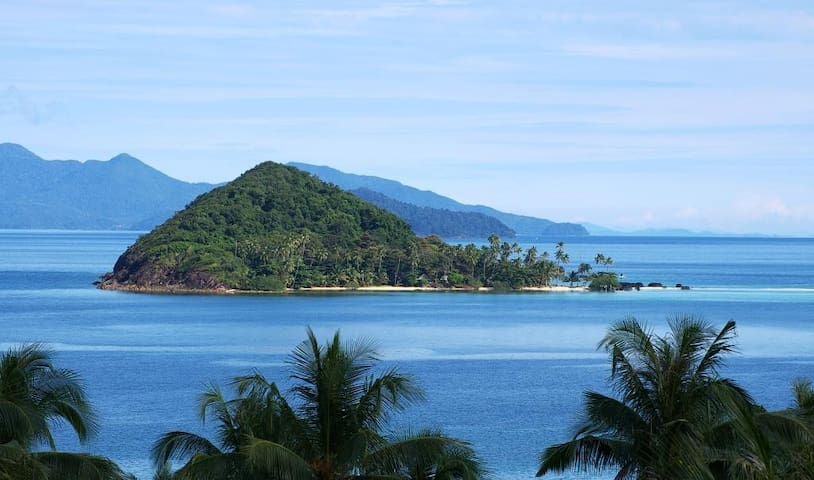 Koh Kham island, only 1000 meters away, 20 minutes by kayak or 10 minutes by boat