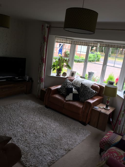 Large living room with Sky TV, Apple TV and Now TV