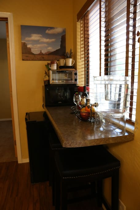 Kitchenette with complimentary wine, mini fridge, microwave, toaster, coffee/keurig/tea maker, tableware, and water dispenser filled with local Sedona spring water.