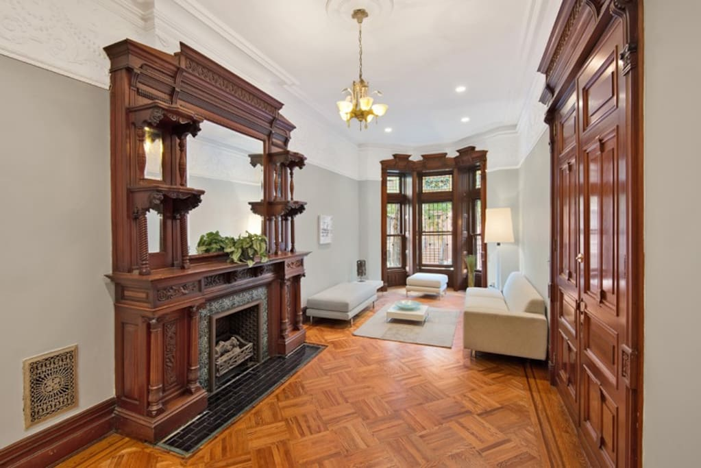 This unique garden duplex with triple parlor and 12-foot ceilings is a hard to find gem.