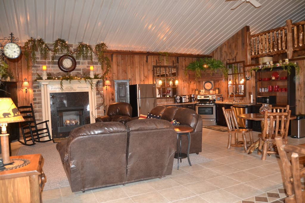 Open floor concept featuring new leather furniture and a functional gas fireplace.
