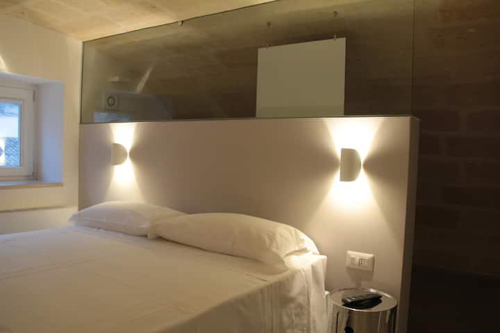 LAMIA room rentals camera Grotta