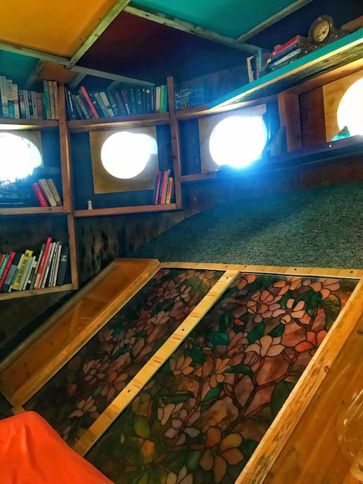 The Library has plenty of natural lighting with sky lights and has stained glass windows overlooking the FUNkey House Living room.