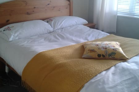 Bright, double room in comfortable house.