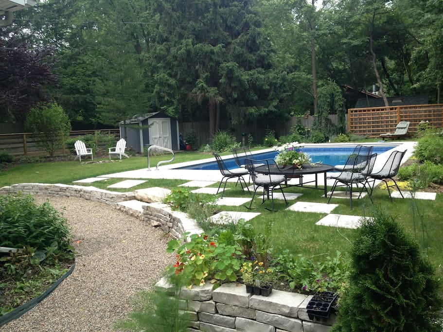 Heated Pool and beautifully landscaped back yard