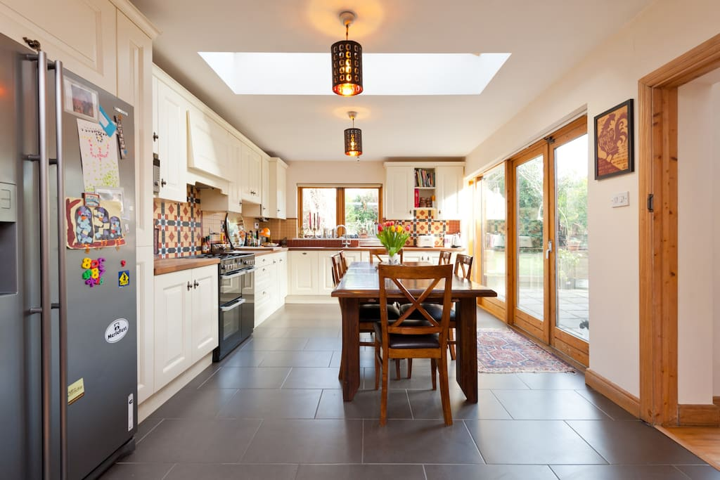 Large kitchen with patio door to garden and outside eating area