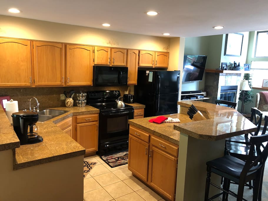 Updated, fully stocked granite kitchen with bar seating for 4, great for social cooking.