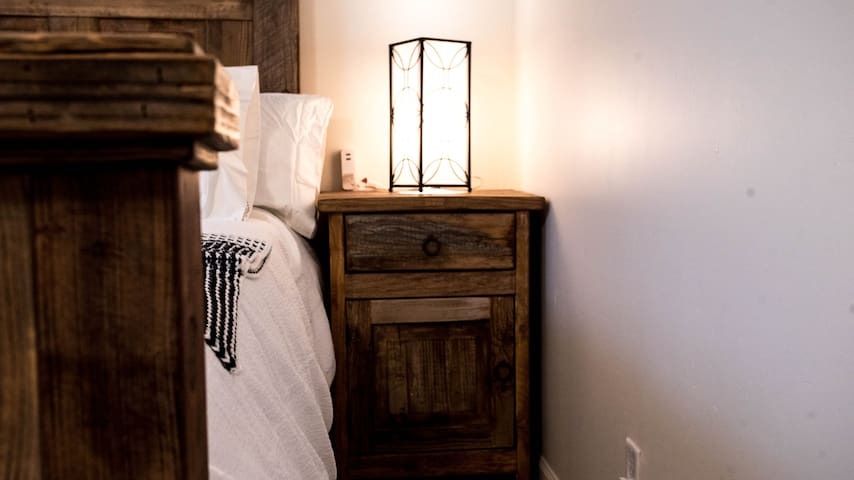 This lamp, with its beautiful design, sheds a soft yet bright light perfect for reading. USB ports are conveniently located for all your charging needs.