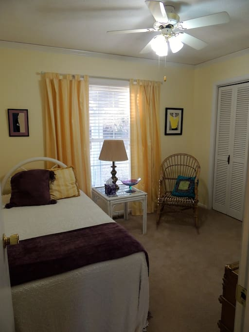 3rd bedroom with twin bed and access to large bath across the hall.
