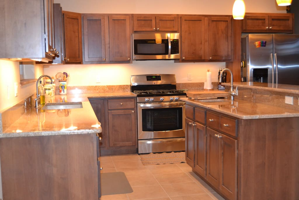 Kitchen with granite counter tops and island