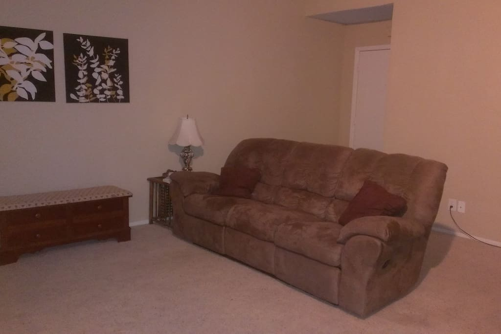 Reclining couch - can sleep two additional people comfortably & plenty of room for an air mattress