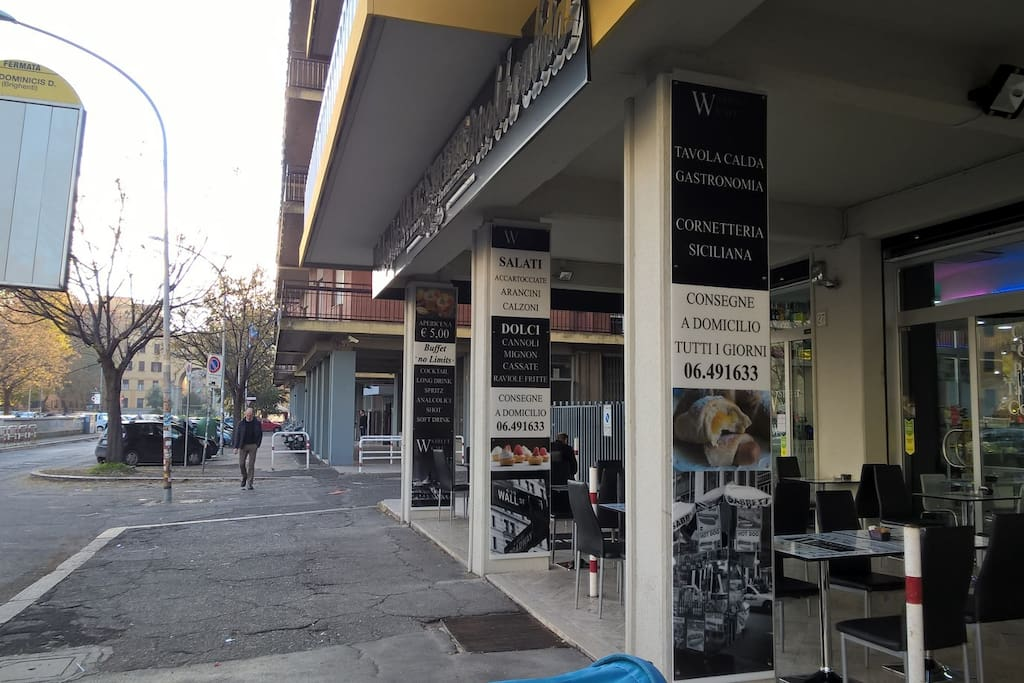 There is a bus stop (number 545) that connects San Lorenzo/University La Sapienza/Tiburtina Station/My House/Pigneto. In front of the bus stop there is a bar