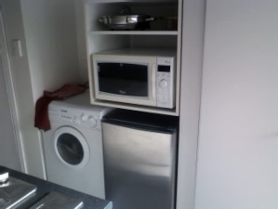Microwave/convection oven, underbench fridge and combined washer/dryer