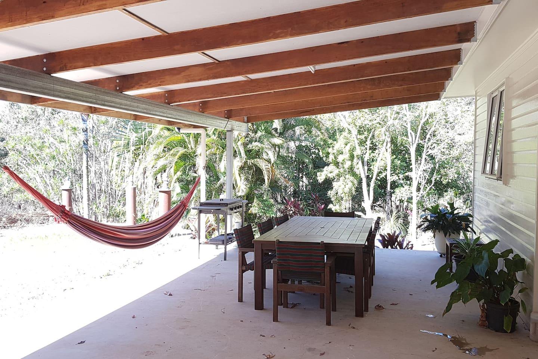 patio overlooking garden with hammock and BBQ