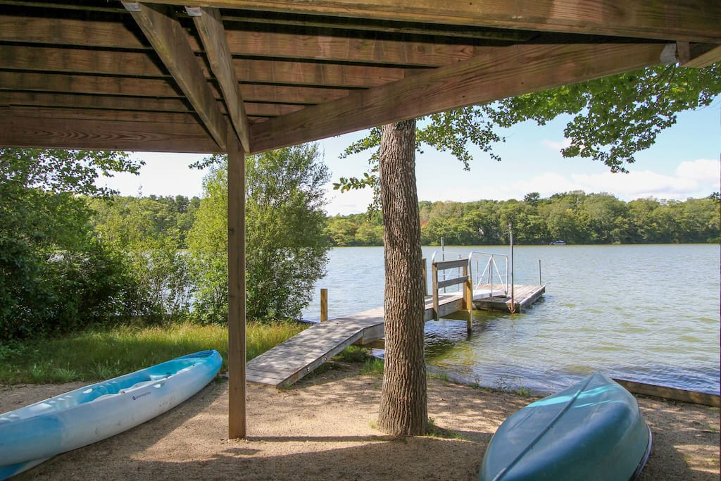 Private dock on the water's edge. Take the canoe or kayak out on the lake.