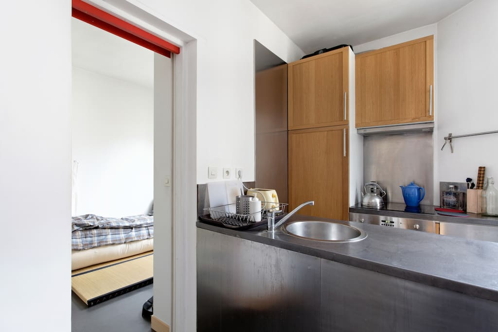 Kitchenette and a look into the bedroom