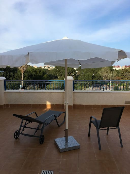 Privat roof terrace with sunbeds and chairs and table