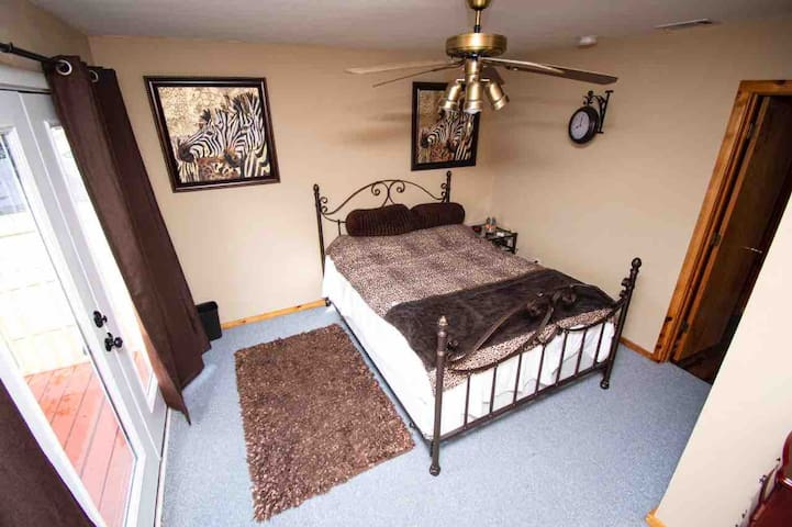 Queen bed in second bedroom for 2 with lake view and walk out balcony