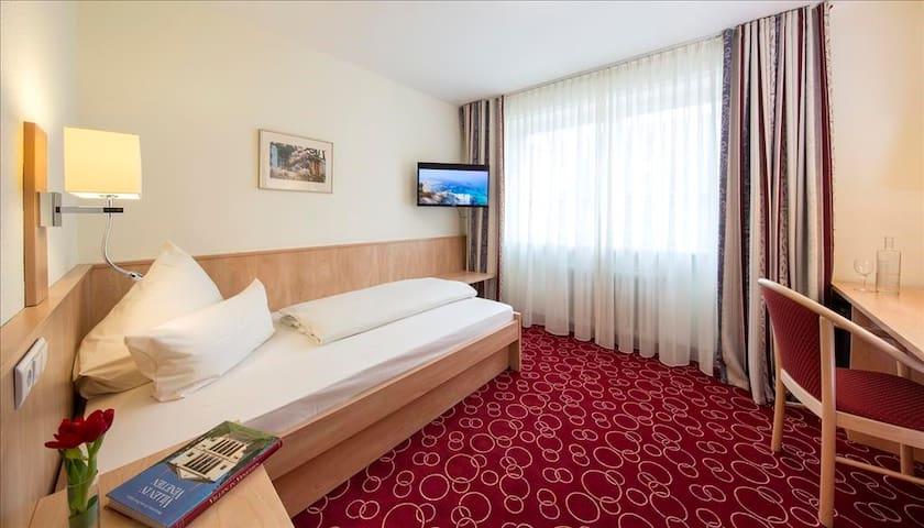 nettes Einzelzimmer mit Klimaanlage