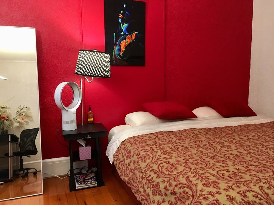 Bedroom with King size bed, powerful & quiet Dyson fan, bedside table with usb charger, and free WiFi