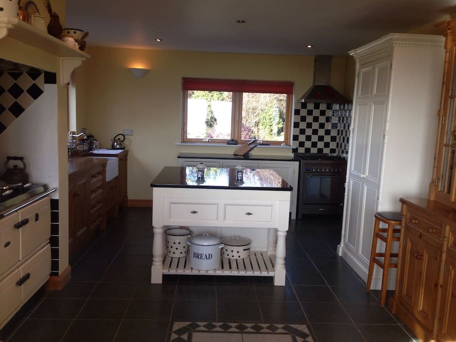 Large open plan kitchen with range oven & separate gas oven, grill & hob.