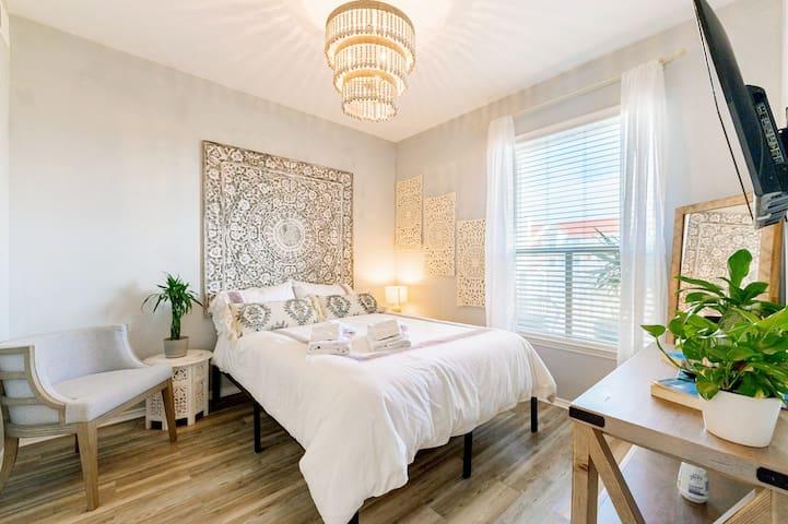 Designer Chandelier adds a bit of glam to the queen bedroom