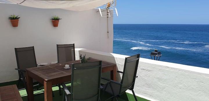 House next to the sea and Playa Jardin beach.