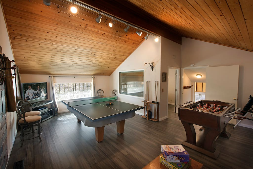 Game room - north view with ping pong table over pool table