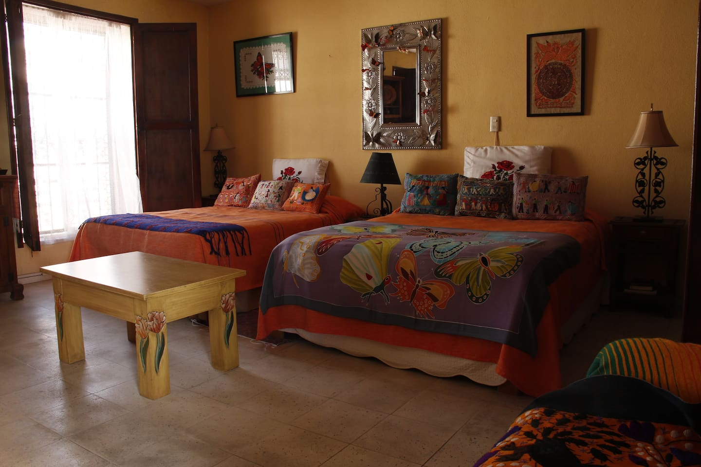 Monarca Suite master bedroom with queen and double beds ~ upstairs, street side. Spacious and light.
