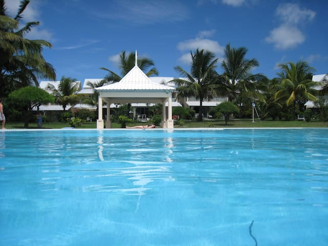 Huge pool with deep and shallow end and separate shallow baby pool
