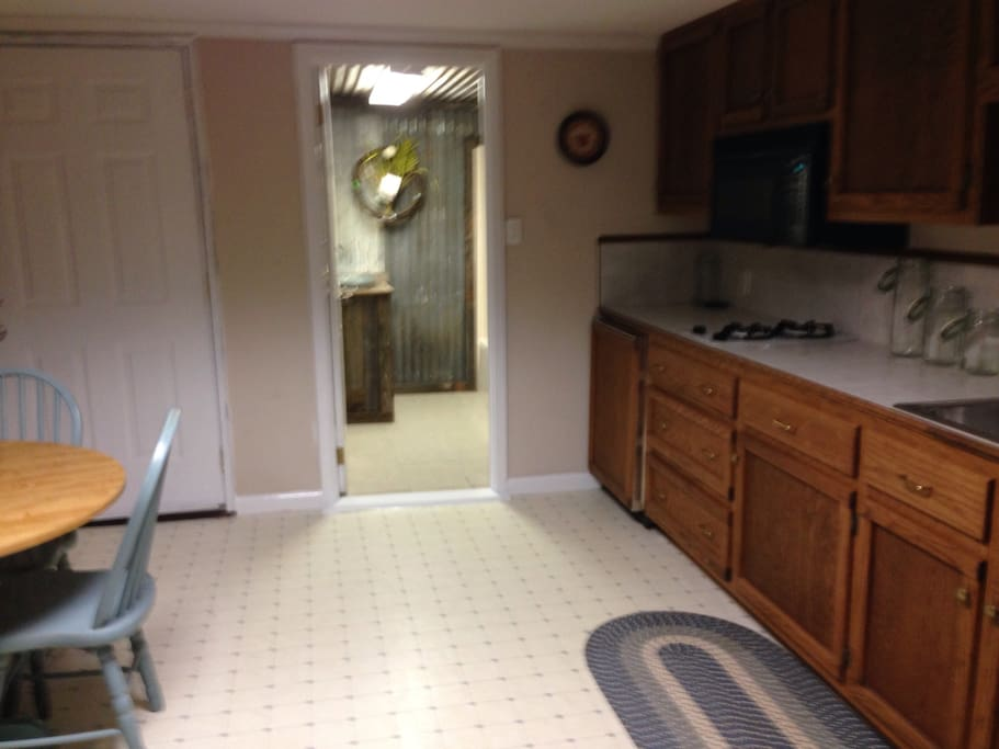 Kitchen area...two burner gas stove, apartment refrigerator, dishes, pots,!pans and other kitchen utensils.