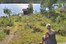 The wiev outside the cabin towards the lake and sauna.