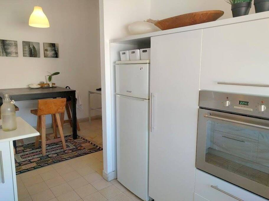 Kitchen with built in stove and oven, a second larger fridge is available