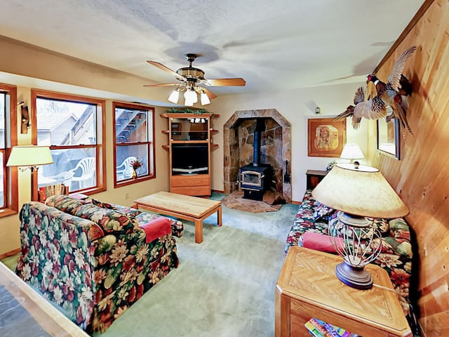 The family room is equipped with a TV, complimentary Wi-Fi, and a wood-burning fireplace.
