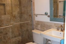 New bathroom with large tiled shower