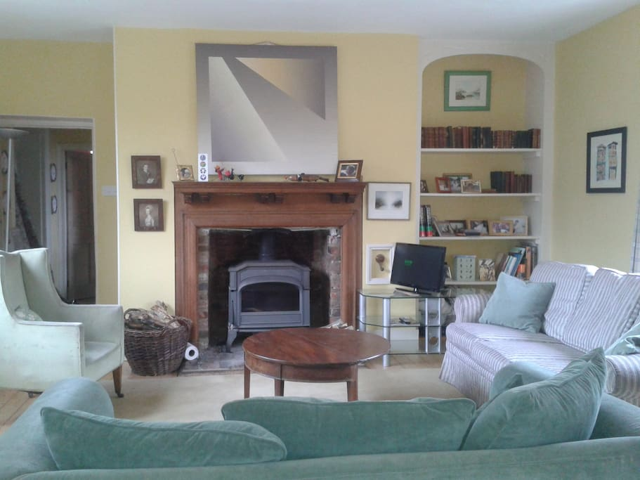 Spacious comfortable sitting room with  woodburning stove