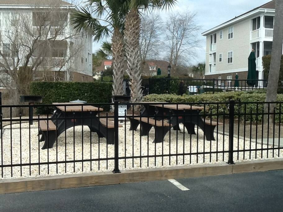 Picnic tables near the BBQ and swimming pool area