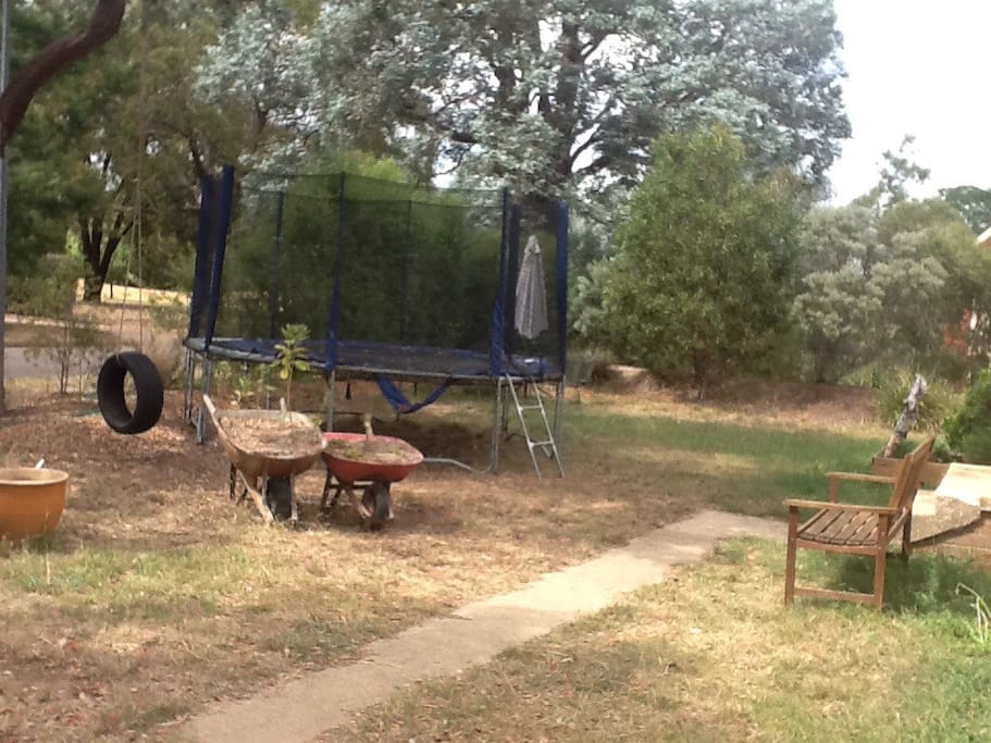 Trampoline and tyre swing at the from of the house.