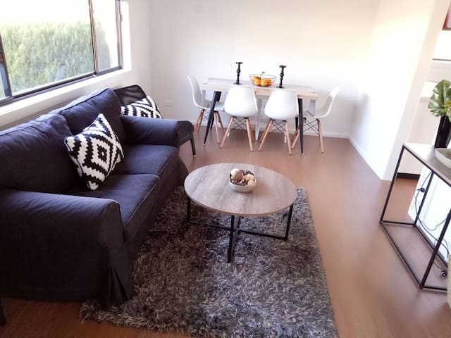 Cozy but cute lounge room with dinning table
