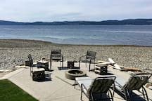 Fire pit on beachfront to enjoy dinner or just star gaze.  In case of fire ban, we have propane fire pit to replace.