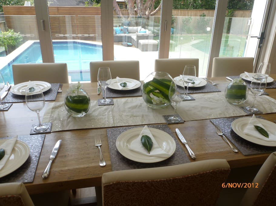 A view from the dining table to the pool