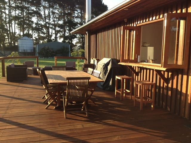 entertainment deck with bbq, lounges, fireplace, dinner table and sunbed